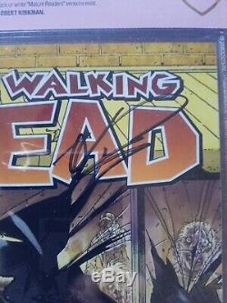 The Walking Dead #1 9.8 CBCS verified signed Robert Kirkman white mature readers