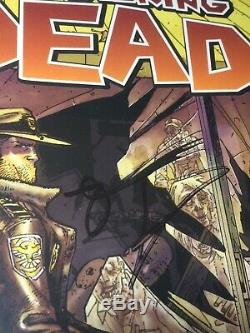 The Walking Dead issue #1 CGC SS 9.8 first printing. Signed by Moore and kirkman